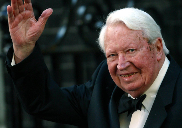 Former British Prime Minister Edward Heath waves as he arrives at number 10 Downing Street in London in this file photo dated April 29, 2002