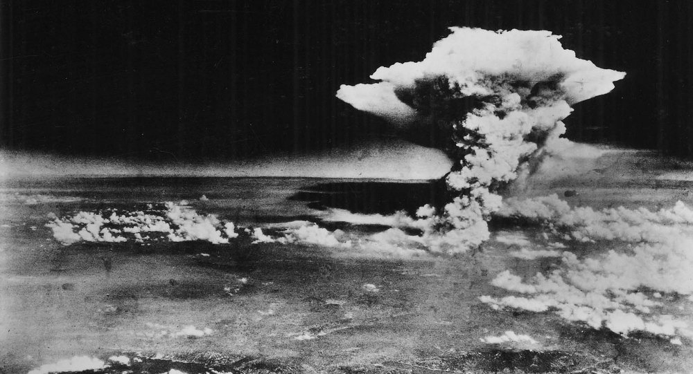 An atomic cloud billows above Hiroshima city following the explosion of the first atomic bomb to be used in warfare in Hiroshima, in this handout photo taken by the U.S. Army on August 6, 1945, and distributed by the Hiroshima Peace Memorial Museum. The words written on the photo are from the source