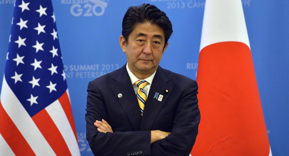 Japan's Prime Minister Shinzo Abe waits for US President to arrive for a bilateral meeting on the sideline of the G20 summit in Saint Petersburg on September 5, 2013.