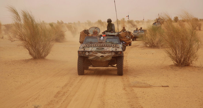 French forces patrol in the desert of Northern Mali along the border with Niger on the outskirts of Asongo, Northern Mali.