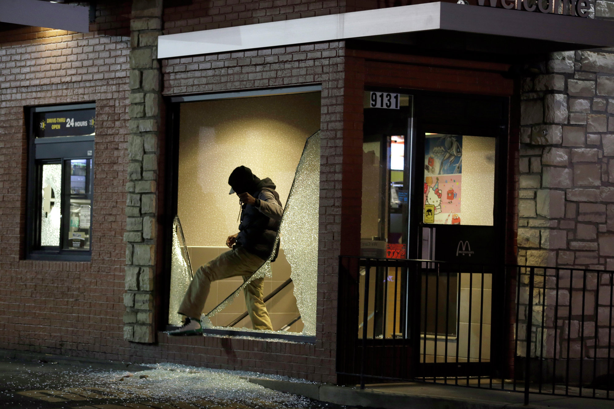 A man steps out of a vandalized store after the announcement of the grand jury decision in Ferguson