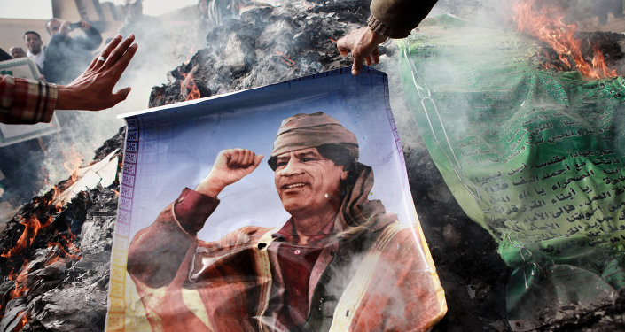 The picture of Muammar Gaddafi being burned. File photo