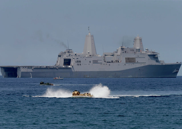 US Navy amphibious assault vehicles with Philippine and US troops on board maneuver in the waters during a combined exercise in the South China Sea. File photo