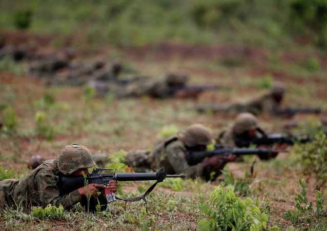 Brazilian Marines take part in a military training in the Formosa Training Camp, in the state of Goias, north of Brasilia, Brazil, Oct. 29, 2014. File photo
