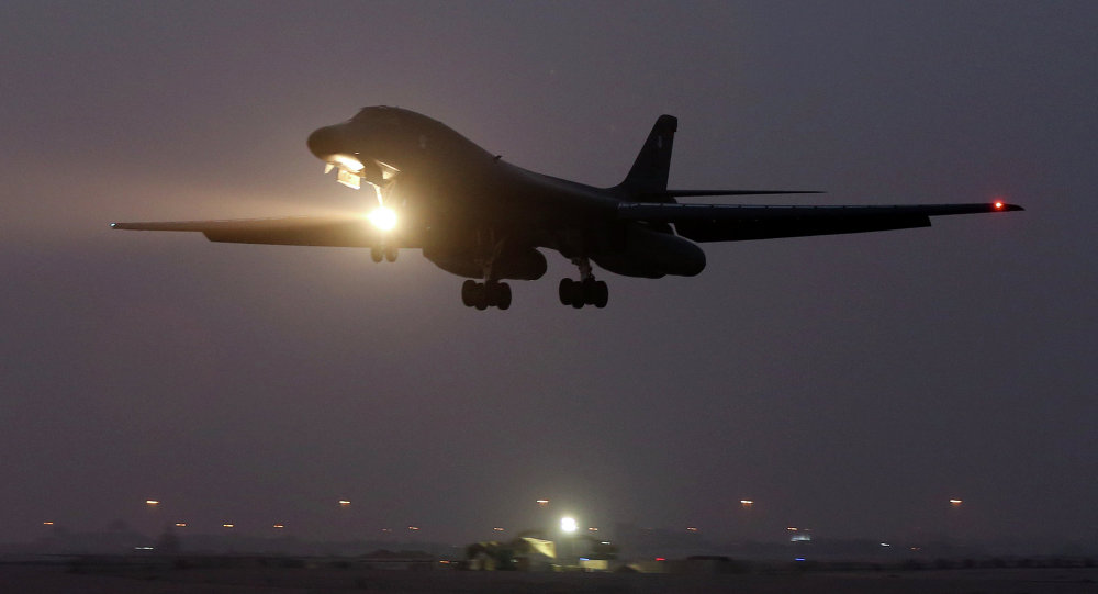 In this photo taken Monday, March 9, 2015, a B-1 bomber prepares to land after finishing a mission at the al-Udeid Air Base in Doha, Qatar