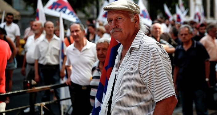 Supporters of the Communist-affiliated PAME labor union take part in an anti-austerity rally outside the Labor Ministry in Athens, Greece, on Wednesday, Aug. 5, 2015.