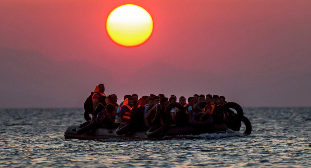 Migrants on a dinghy arrives at the southeastern island of Kos, Greece, after crossing from Turkey, Thursday, Aug. 13, 2015