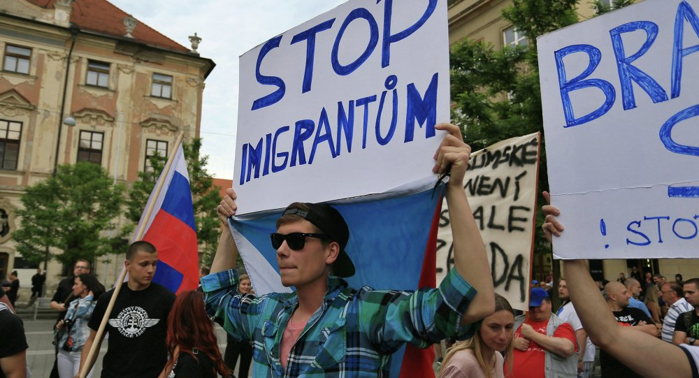 Anti-migrants protesters hold banners reading 'Stop Immigration' on June 26, 2015 in Brno, Czech Republic during an anti-Islam and immigration rally