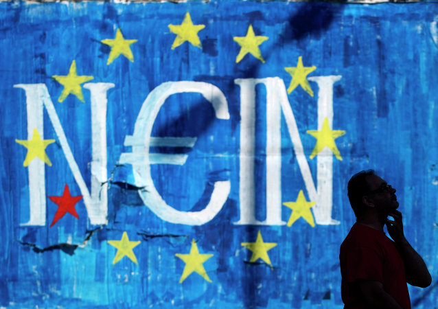 A man walks past a graffiti made by street artist N_Grams showing the EU flag and the German word for 'no', but with the letter 'e' in the shape of the Euro symbol, in Athens