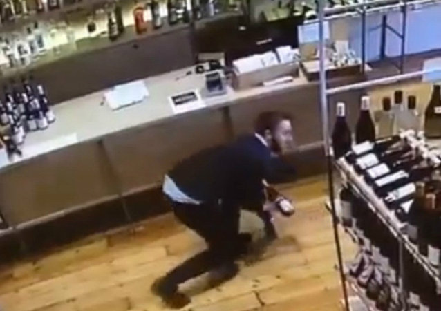 Nice Catch! Store Employee Dives to Save a Bottle of Wine