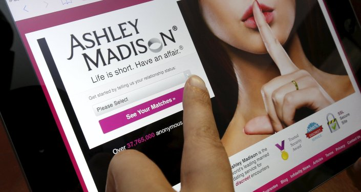 The homepage of the Ashley Madison website is displayed on an iPad, in this  photo