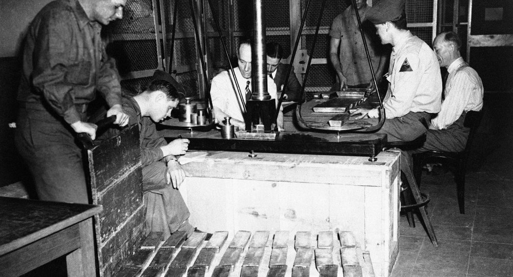 US Mint officials and G.I.'s are sorting out millions of dollars-worth of German bullion in the Reichsbank vaults at Frankfurt, Germany. Identification and assaying alone, will take weeks according to Leland Howard, Assistant Director of the US Mint.