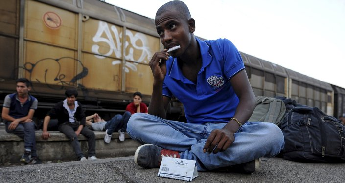An immigrant from India rolls a cigarette at Gevgelija railway station, Macedonia August 19, 2015