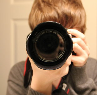 A kid with photo camera