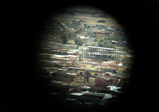 A picture taken through a machine gun sight on August 17, 2015 shows buildings that were damaged during fighting between Iraqi Kurdish Peshmerga fighters and the Islamic State (IS) group's militants in the northern Iraqi town of Sinjar, west of the city of Mosul.