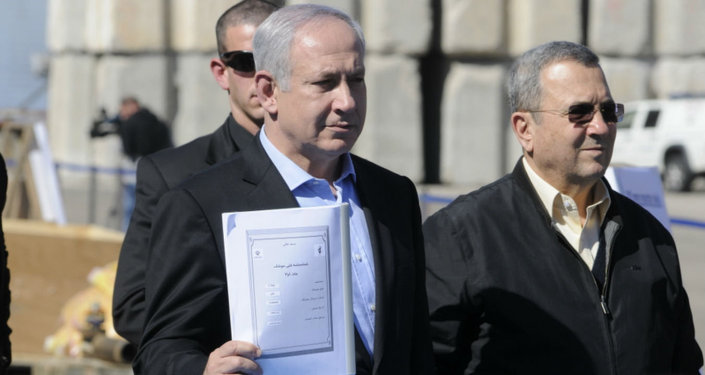 Prime Minister Mr. Benjamin Netanyahu and Defense Minister, Mr. Ehud Barak hold an Iranian instruction manual for the C-704 anti-ship missile.