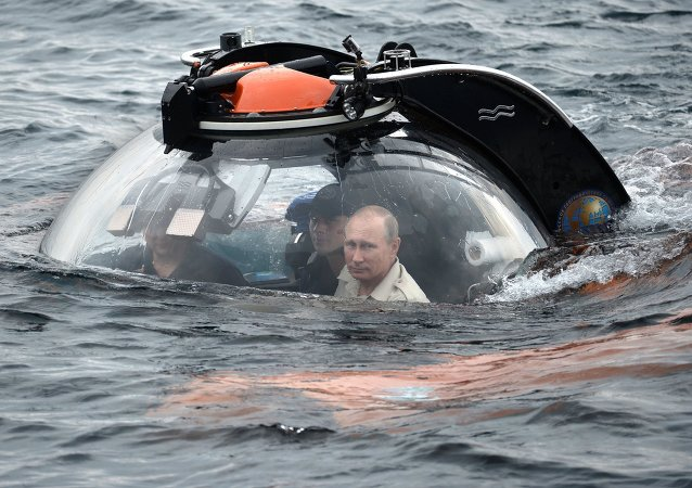 Russian President Vladimir Putin, right, submerges 83 meters under water on board a bathyscaphe near Sevastopol to see a sunken ancient vessel
