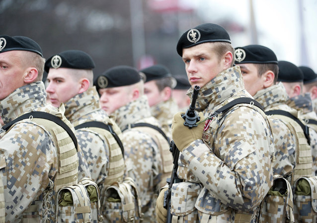 Latvian soldiers stand during a military parade