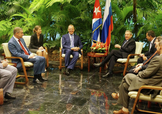 Russian Foreign Minister Sergey Lavrov, center left, and President of the Council of State of Cuba Raul Castro, center right, during talks in Havana
