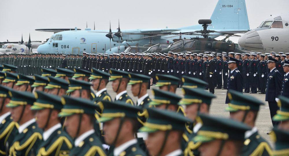 Soldiers are aligned prior to their review ceremony on a runway at the Japan Air Self-Defense Force's Hyakuri air base in Omitama, Ibaraki prefecture