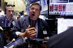 Trader John Santiago, center, works on the floor of the New York Stock Exchange, Monday, Aug. 24, 2015
