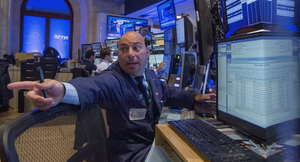 Traders work on the floor of the New York Stock Exchange August 24, 2015