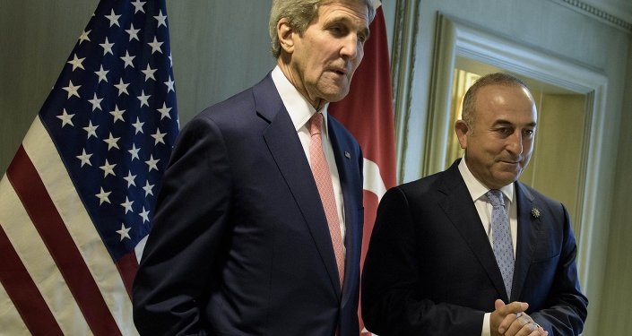 US Secretary of State John Kerry, left, and Turkey's Foreign Minister Mevlut Cavusoglu