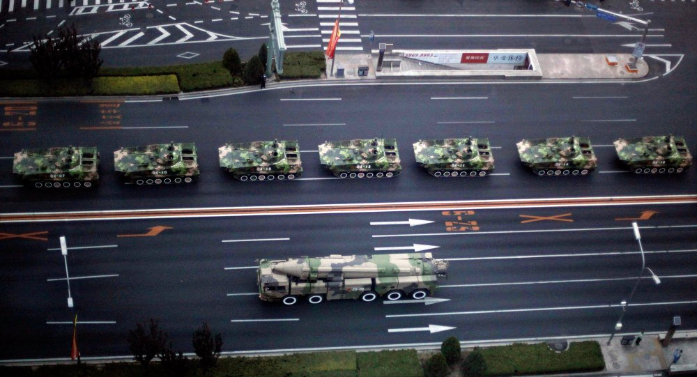 Military vehicle carrying a DF-21D carrier-killer missile, bottom, and other Chinese military vehicles head towards Tiananmen Square