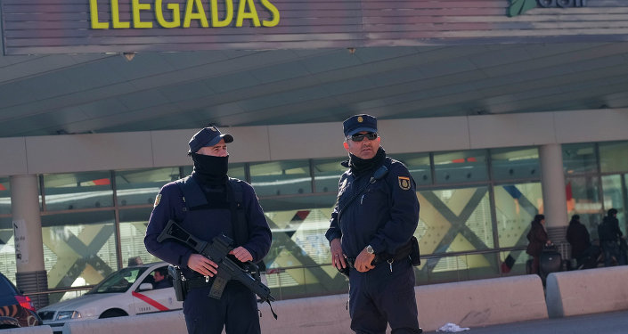 Police stand guard in front of teh Atocha train station in Madrid