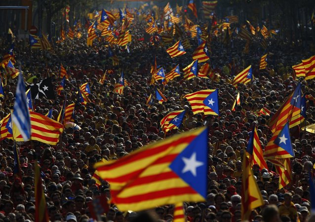 "Hundreds of thousands of demonstrators stand on the streets waving their ""estelada"" flags, that symbolizes Catalonia's independence, during a protest calling for the independence of Catalonia in Barcelona, Spain"
