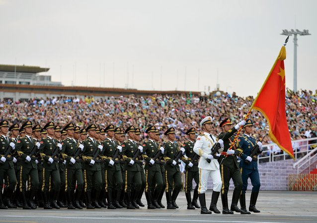 Soldiers of China's People's Liberation Army (PLA) march during a rehearsal for a military parade in Beijing, August 23, 2015