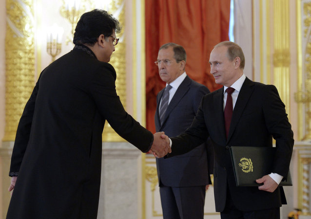 From right: Russian President Vladimir Putin, Russian Foreign Affairs Minister Sergei Lavrov and Ambassador of the Islamic Republic of Pakistan Zaheer Aslam Janjua during the ceremony of presenting credentials from new foreign ambassadors in the Grand Kremlin Palace's Alexander Hall