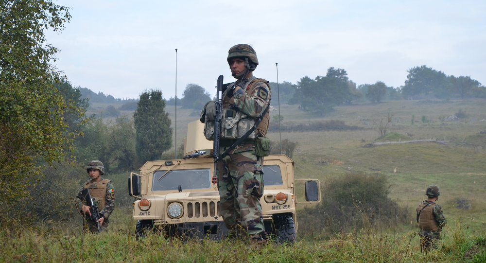 Moldovan soldiers of the Peacekeeping Battalion provide security during a Kosovo Force (KFOR) mission rehearsal exercise (MRE) at the Joint Multinational Readiness Center (JMRC) in Hohenfels, Germany, Oct. 1, 2014
