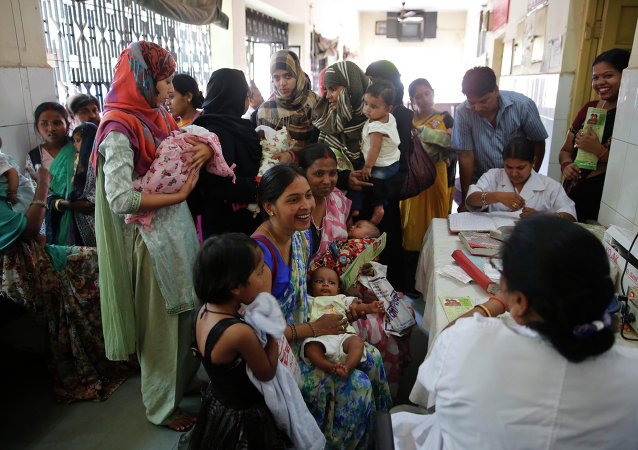 Indian women wait to get their infants immunized as part of  an immunization drive at a government hospital in Allahabad, India.