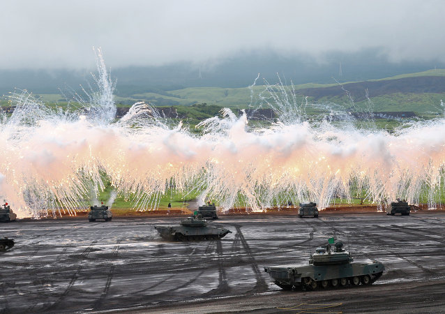 Japan Ground Self-Defense Force's Type-89 armored combat vehicles flare up a smoke screen during an annual live firing exercise at Higashi Fuji range in Gotemba, southwest of Tokyo.