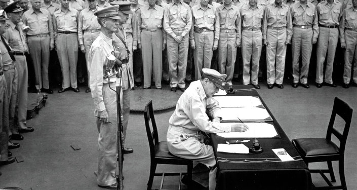 Gen. Douglas MacArthur signs the Japanese surrender documents, September 2, 1945, aboard the USS Missouri in Tokyo Bay.