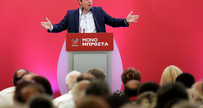 Outgoing Greek Prime Minister and the Syriza party leader Alexis Tsipras speaks to a gathering of his party members in Athens, on Saturday, Aug. 29, 2015.