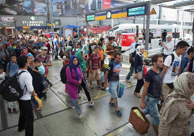 Migrants arrive to the main railway station in Munich, Germany, September 1, 2015
