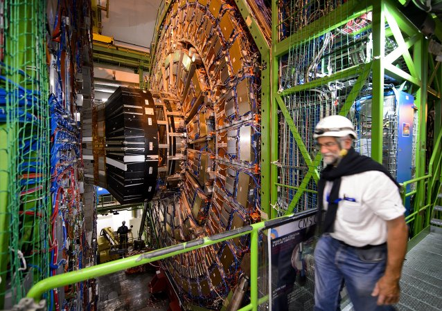 A worker walks past the CERN's Compact Muon Solenoid (CMS), a general-purpose detector at the Large Hadron Collider (LHC), during maintenance works