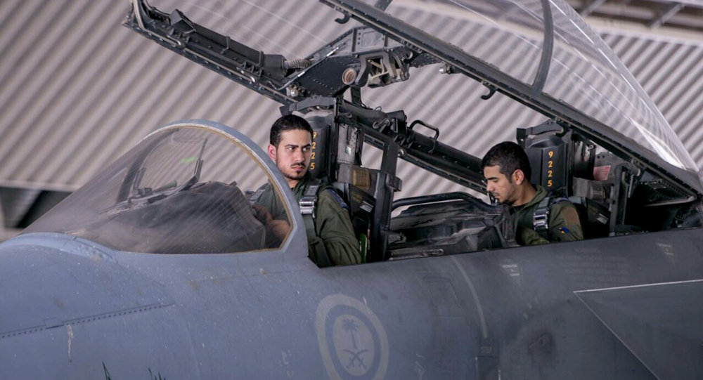 FILE - In this file photo released Sept. 24, 2014 by the official Saudi Press Agency, Saudi pilots sits in the cockpit of a fighter jet as part of US-led coalition airstrikes on Islamic State militants and other targets in Syria, in Saudi Arabia