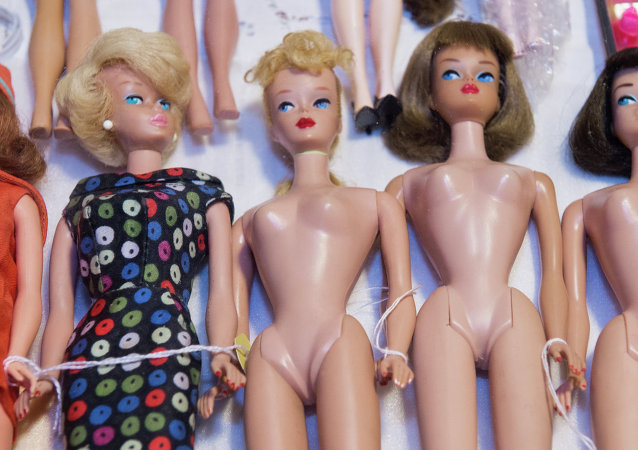 Barbie dolls are seen for sale during the 2015 National Barbie Doll Collectors Convention in Arlington, Virginia on July 30, 2015