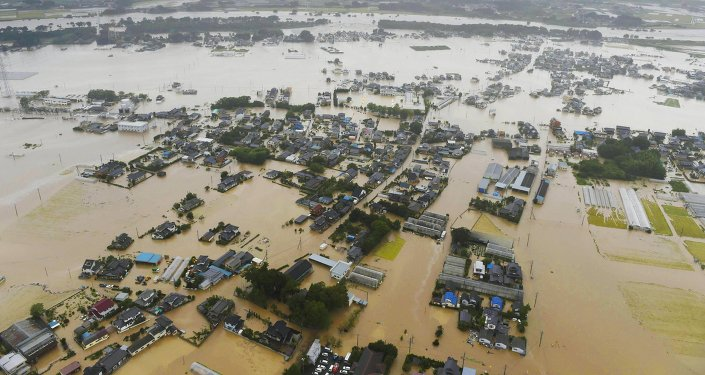 An aerial view shows residential areas flooded by the Kinugawa river (top), caused by typhoon Etau in Joso, Ibaraki prefecture, Japan, in this photo taken by Kyodo September 10, 2015