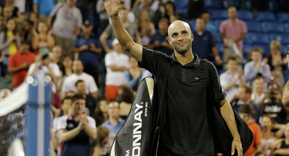 James Blake waves to fans as he leaves the court after being defeated by Ivo Karlovic, of Croatia, in a first round match at the U.S. Open tennis tournament Thursday, Aug. 29, 2013, in New York.
