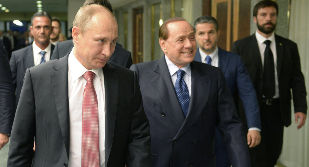 Russian President Vladimir Putin, left, and former Italian prime minister Silvio Berlusconi at their meeting in Rome, June 10, 2015