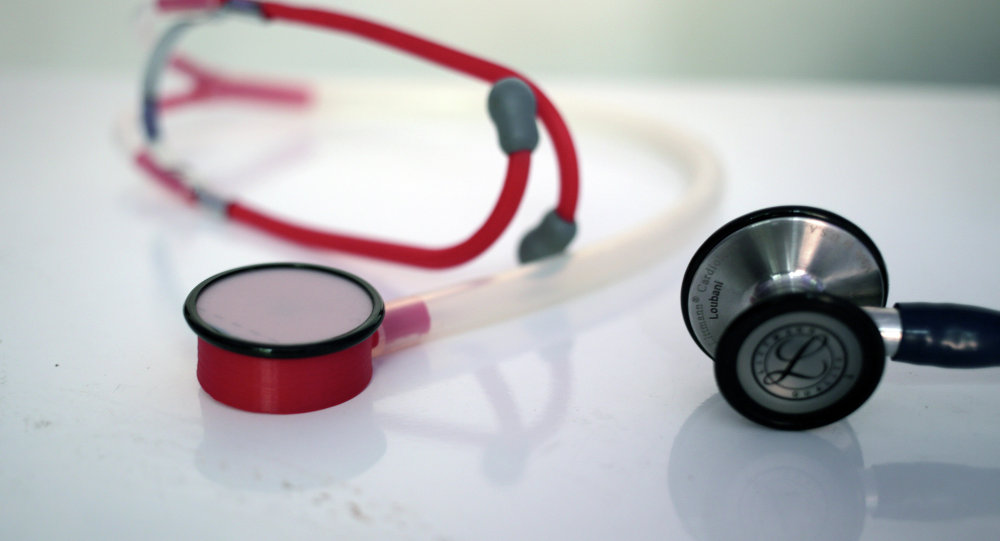 In this Monday, Sept. 7, 2015 photo, a 3D printed stethoscope, left, is seen next to a traditional medical stethoscope in Gaza City.
