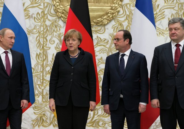 From the left : Russian President Vladimir Putin, German Chancellor Angela Merkel, French President Francois Hollande, and Ukrainian President Petro Poroshenko pose for a photo during a time-break in their peace talks in Minsk, Belarus, Wednesday, Feb. 11, 2015. Leaders of Russia, Ukraine, France and Germany are gathering for crucial talks in the hope of negotiating an end fighting between Russia-backed separatist and government forces in eastern Ukraine.