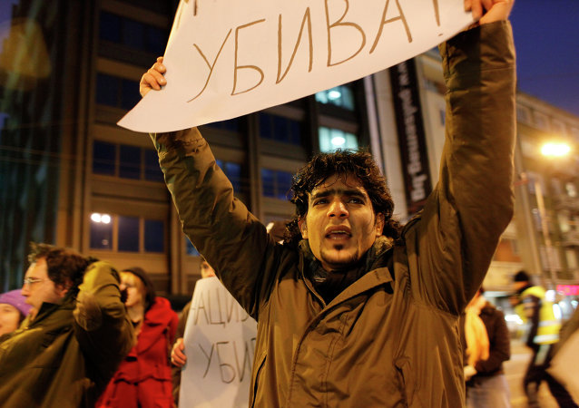 Protestor holds a poster reading Keeping silence might kill, as he shouts slogans during a flash mob demonstration by refugees and migrants that has closed the main street to traffic, in Sofia, Bulgaria, Friday, Feb. 25, 2011