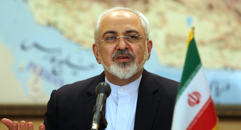 Iranian Foreign Minister Mohammad Javad Zarif and the head of Iran's Atomic Energy Organization Ali Akbar Salehi (unseen) give a press conference at Tehran's Mehrabad Airport following their arrival on July 15, 2015, after Iran's nuclear negotiating team struck a deal with world powers in Vienna