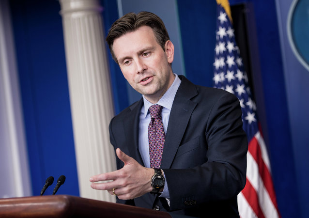 White House Press Secretary Josh Earnest speaks during a daily briefing at the White House October 15, 2014 in Washington, DC.