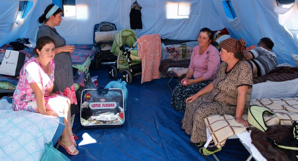 Women in a tent camp for refugees from Donbass